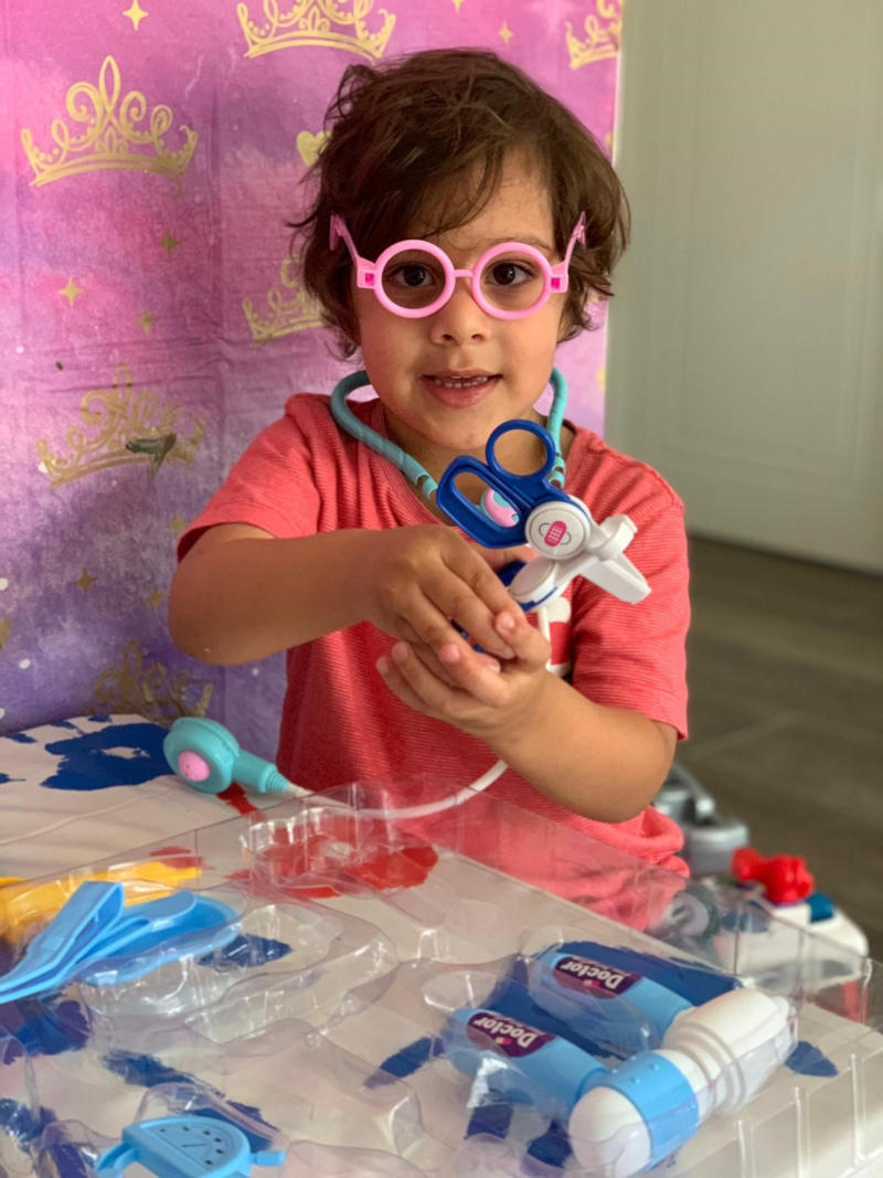 Toddler playing with doctor's toys